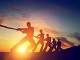 Group of people, team pulling line, playing tug of war. Teamwork - 77241965
