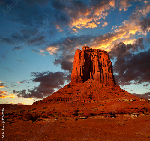 In de dag Oranje eclat Monument Valley, USA colorful sunrise or sunset with dramatic clouds, desert landscape of Navajo Nation Park in Utah and Arizona, a famous travel destination for it's red rock formations