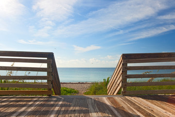 Wooden deck with fence overlooking the ocean