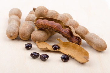Dried Tamarind Fruits With Seeds On Wood