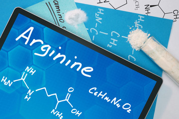 Tablet with the chemical formula of  Arginine . Amino acids.
