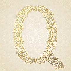 Gold font type letter Q, uppercase.