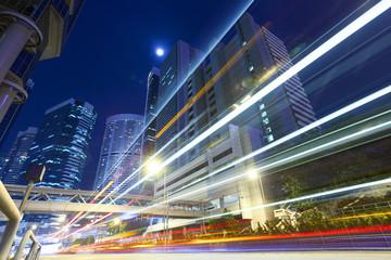 traffic light trails at modern city street,hongkong.