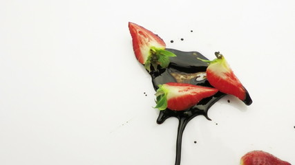 strawberry falling into chocolate sauce slow motion