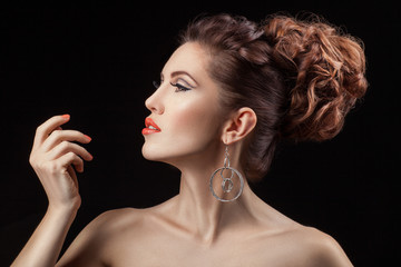 Girl in profile with a coral lip color.