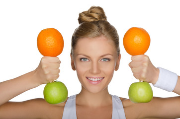 young woman with dumbbells from apples and oranges