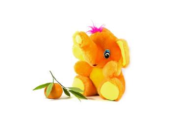 bright orange toy elephant and tangerine