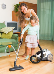 Family cleaning home with vacuum cleaner