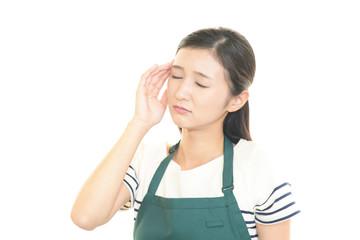 頭痛を訴える主婦