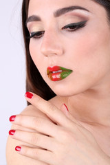 Girl with beautiful lips and nails, closeup