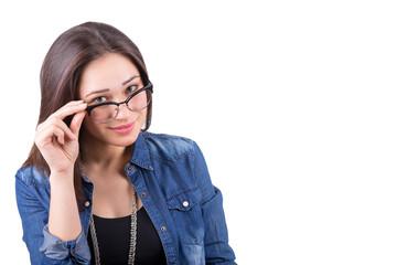 beautiful girl looks over glasses holding frame