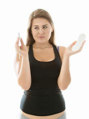cute woman in lingerie holding tampon and menstrual pad