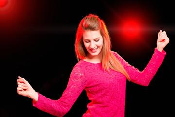 Woman dancing in a disco