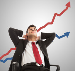 Businessman looking at a growing graph
