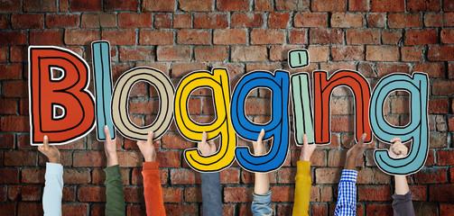 Diverse Hands Holding Word Blogging Concept