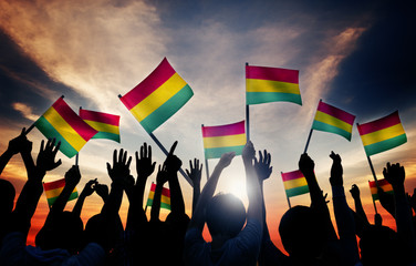 People Holding Red Yellow Green Striped Flag Concept