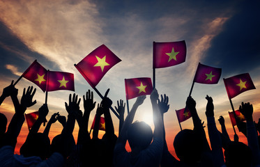 Group People Waving Vietnamese Flags Back Lit Concept