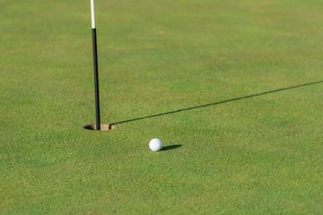 Golf ball and pin