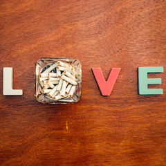 word love on a wooden board