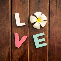 word love on the wooden table