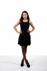Attractive Latina Woman Standing Black Dress Arms Akimbo