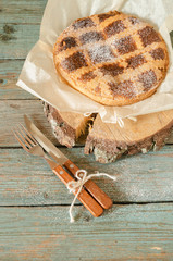 Neapolitan pie with wheat and ricotta on wooden table