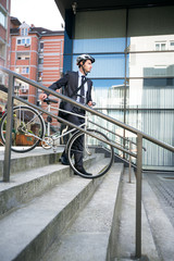 Attractive businessman with  his bike