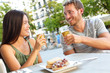 Couple eating tapas drinking beer in Madrid Spain - 77276994