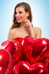 woman with Valentine's Day balloons