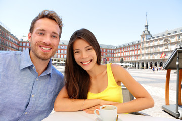 Madrid tourists at cafe drinking coffee selfie