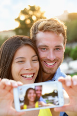 Couple in love taking selfie photo with smartphone