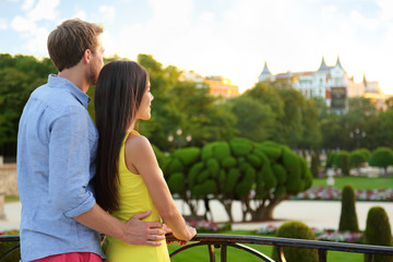 Romantic couple embracing enjoying view in park