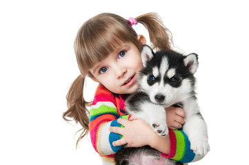 Girl with a puppy husky