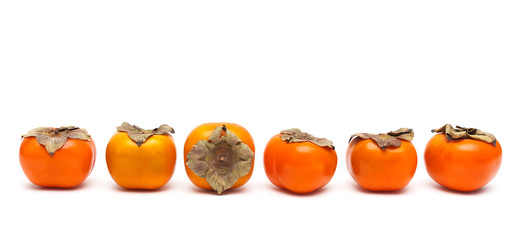 ripe persimmon isolated on white background close-up