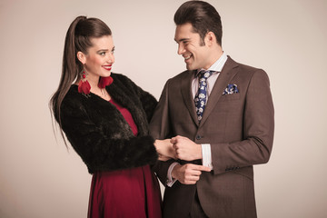 Happy young fashion couple laughing
