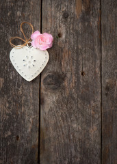 Vintage heart shaped decoration on a wooden surface