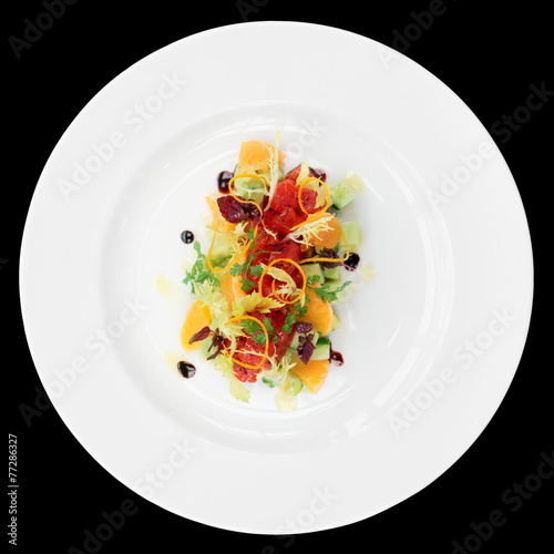 Tuna tartar with cucumber and orange, isolated