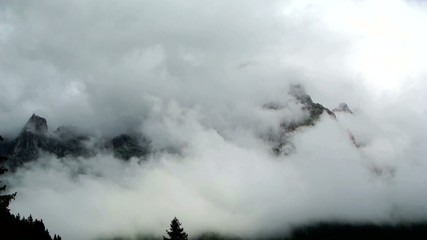 Clouds through the mountains Dolomites