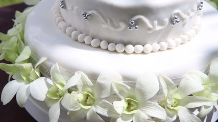 fresh white orchid and beads decorated wedding cake