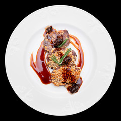 Venison fillet fried with pine nuts, isolated