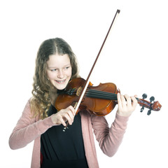 young girl with blond curly hair plays the violin in studio