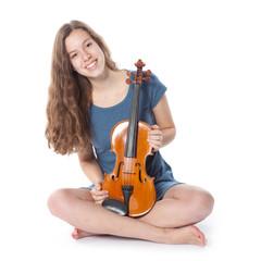 teenage girl in minidress sits with violin in studio