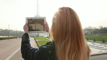 Tourist in Paris takes picture with digital tablet-Eiffel tower