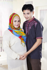 Islamic couple standing in bedroom