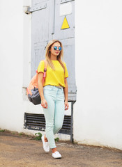 Summer, fashion and people concept - stylish hipster girl