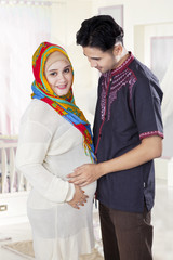 Islamic pregnant woman and her husband