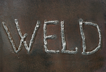 Caption - welding.  is made by welding in the form of letters.