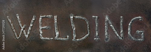 Caption - welding. is made by welding in the form of letters. - 77293128