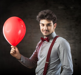 Smiling man with a red balloon