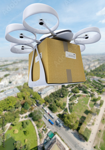 Commercial drone flying above a big city - 77294982